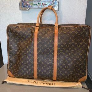 Authentic Louis Vuitton Sirius 65 travel duffle